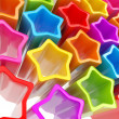 Festive background made of extruded colorful stars — Stock Photo