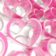 Pink and white glossy hearts composition background — Stock Photo