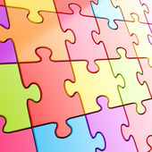 Puzzle jigsaw background made of coloful pieces — Stock Photo
