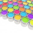 Buckets full of rainbow colored oil paint - Stock Photo
