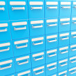 Accurate infinite rows of drawers as business background — Stock Photo #13907710
