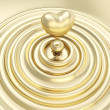 Stock Photo: Heart symbol made of liquid gold metal