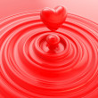 Stock Photo: Heart symbol made of liquid cream or soap