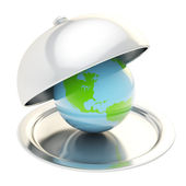 Earth globe on ceramic salver under a chrome food cover — Stock Photo