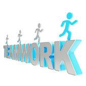 Human running symbolic figures over the word Teamwork — Stock Photo