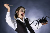 Mad vampire boy prepared to stab a spider — Stock Photo