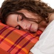 Stock Photo: Woman Sleeping in a Red Pillow