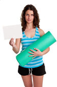 Woman Holding a Mat and a White Empty Card — Stock Photo