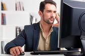 Man Looking At A Computer Monitor — Stock Photo
