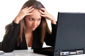 Worried Woman Looking At A Computer Monitor — Stock Photo