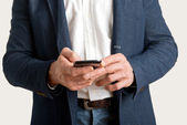 Casual Businessman messaging on a phone — Foto de Stock