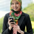 Scarf girl use smart phone — Stock Photo