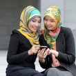 Two Scarf girl use smart phone — Stock Photo