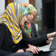 Two Scarf girl use laptop — Stock Photo