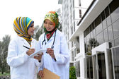 Two Women Doctor With Scarf, Outdoor — Stock Photo