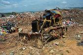 Bulldozer working in a landfill — Stock Photo