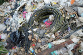 Rubbish electric cable on the field — Stock Photo