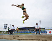 Long jump female sky canada — Stock Photo