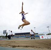 Long jump woman leap sky canada — Stock Photo