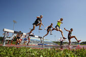 Steeplechase Track Men Jump Water — Stock Photo