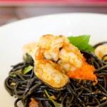 Постер, плакат: Seafood and black spaghetti