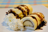 Banana crepe rolls and cream — Stock Photo