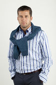 Man in shirt and vest — Stock Photo