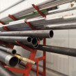 Stock Photo: Metal pipe stack on shelf