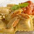 Stock Photo: Ravioli with tomato sauce