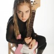 Teenage girl jumping with an electric guitar — Stock Photo #25493497