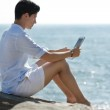 Young man using Digital Tablet — Stock Photo