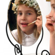 Adolable little girl looking in a mirror — Stock Photo