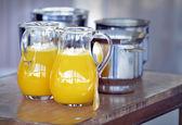 Jug and glass with orange juice — Stock Photo