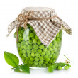 Green peas in glass jar — Stock Photo