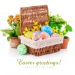 Easter eggs in basket with spring flowers — Stock Photo #19090603