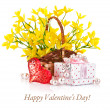 Gift with red heart and yellow flowers in basket — Stock Photo