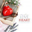Red heart with key in retro box - Stock Photo