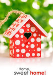 Red birdhouse in white polka dot — Stock Photo