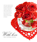 Red roses with green leaf in a vase — Stock Photo