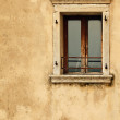 Vintage window on old wall — Stock Photo