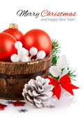 Christmas tinsel with branch firtree and red balls — Stock Photo