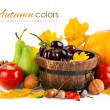 Autumnal harvest fruits and vegetables with yellow leaves — Stock Photo #32329219