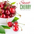 Fresh cherry berries with green leaf — Photo
