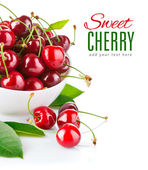 Fresh cherry berries with green leaf — Stock Photo
