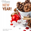 Pinecone in bucket with christmas tinsel — Stock Photo