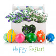 Easter eggs in wooden basket with spring flowers — Stock Photo #38426921