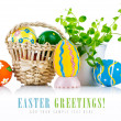 Easter eggs in basket with spring leaves — Stock Photo