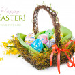 Easter eggs in basket with spring flowers — Stock Photo #38714303