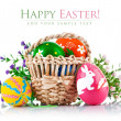 Easter eggs in basket with spring flowers — Stock Photo #38724725