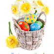 Easter eggs in basket with spring flowers — Stock Photo #44367149